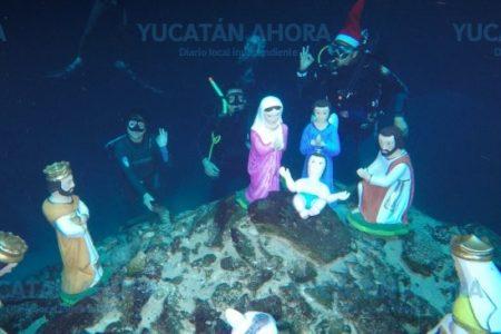 Buzos instalan pesebre en las profundidades de icónico cenote de Yucatán