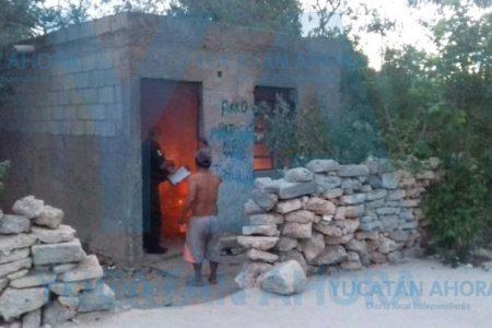 A cubetazos, salvan a borracho de un incendio