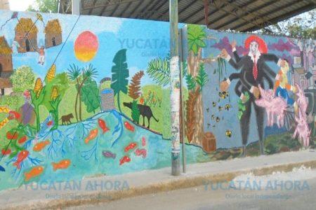 Niños plasman en mural el antes y después de Kekén en Kinchil