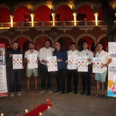 Se tiñe de rojo el Palacio Municipal de Mérida, por la lucha contra el VIH Sida