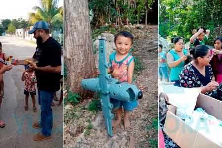 Padre e hija llevan juguetes y ropa a niños pobres