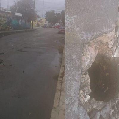 Lluvias dejan 'socavón' en medio de una calle, en la Fidel Velázquez