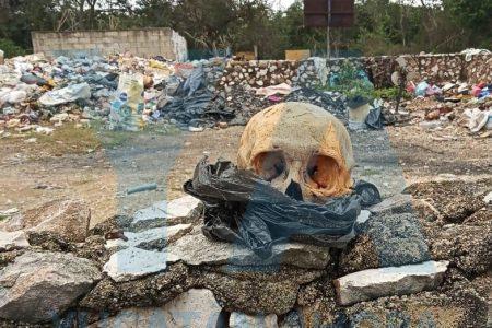 Pepenadora halla cráneo humano usado en brujería, en el relleno sanitario