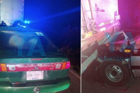 Chocan patrulla estacionada que auxiliaba un tráiler averiado: dos heridos