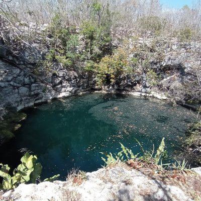 Fallece buzo en cenote de Huhí: se le cayó su lámpara, se metió al agua y ya no salió más